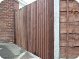 bow top closeboard double timber drive gates.