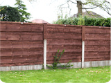 5ft waney-lap fence panels in 3ft concrete fence posts with 2ft wooden fence post extenders.