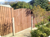 5ft arch top vertical lap panels in 3ft posts with 2ft fence post extensions.