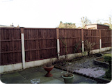 5ft closeboard fence panels in varied concrete posts with varied wooden fence post extensions.