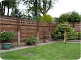 6ft waneylap and trellis panels in 3ft concrete fence posts with 3ft fence post extensions.