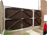 Tripple tongue and groove driveway gates fitted to new concrete and timber gate posts.