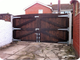 Regular heavy duty wooden estate gates at a house in Whitefield.