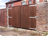 Double wooden yard gates fitted in Radcliffe. These gates were fitted outward opening because of yard space restrictions.