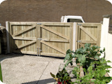 Matching double with single tongue and groove wooden gates to secure a yard in Middleton.