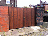 Treated tongue and groove timber entrance gates.