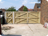 Tripple configuration tongue & groove timber gates installed in Stockport.