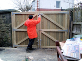 Wooden double garden entrance gates at a yard in Farnworth.