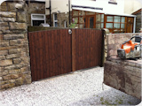 Arched double wooden yard gates fitted in Bury.