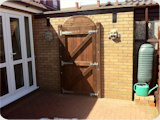 Arch top wooden garden gate to fit a garden wall with an arch in Bury.