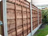 4ft waney lap wooden fence panels, topped with a 1ft trellis.